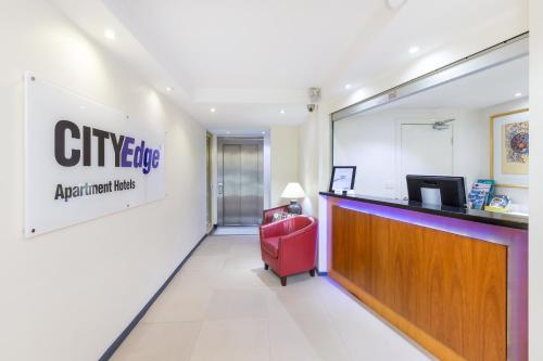 The lobby or reception area at City Edge East Melbourne Apartment Hotel