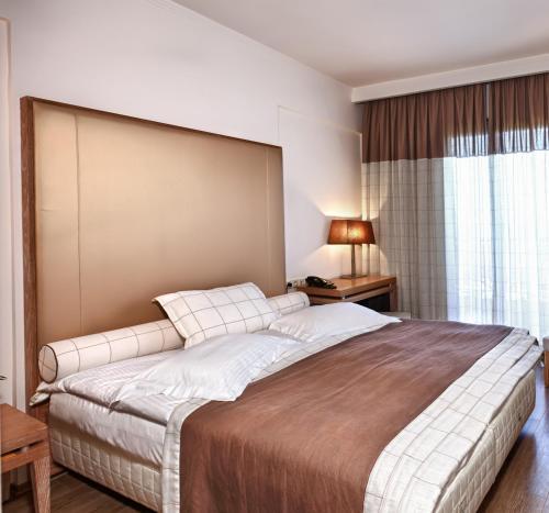 Ένα ή περισσότερα κρεβάτια σε δωμάτιο στο Olympus Thea Boutique Hotel