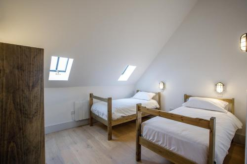A bed or beds in a room at The Sail Loft