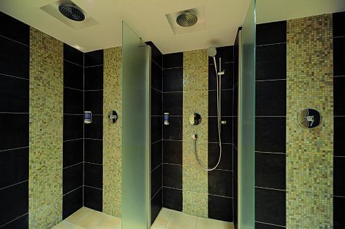Ein Badezimmer in der Unterkunft König