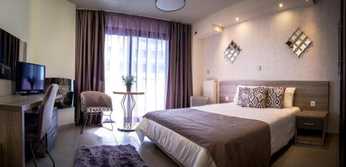 A bed or beds in a room at Limani Comfort Rooms