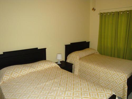 A bed or beds in a room at Hotel Santander SD