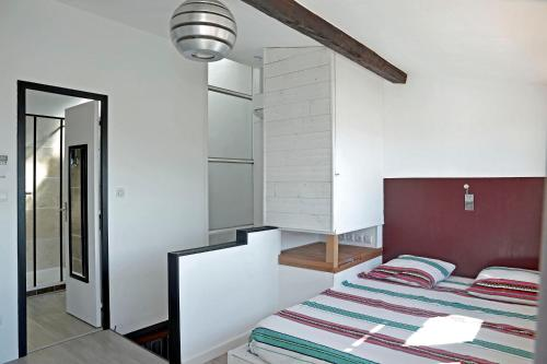 A bed or beds in a room at Duplex Panier