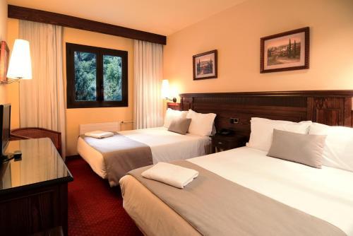 Cama o camas de una habitación en RVHotels Tuca