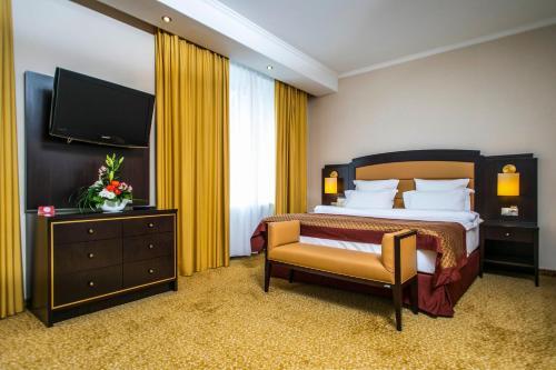 Кровать или кровати в номере Гостиница Арбат