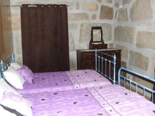 A bed or beds in a room at Casa da Bôcha
