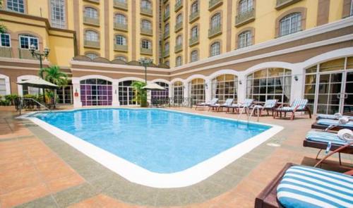 The swimming pool at or near Hilton Princess Managua
