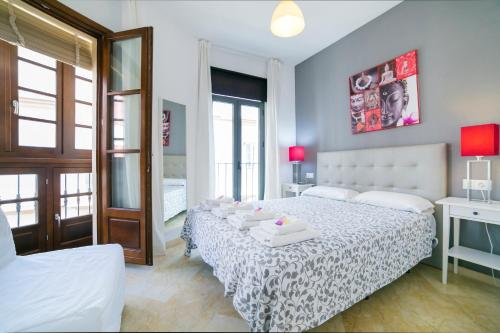 Säng eller sängar i ett rum på Apartamentos Salamanca