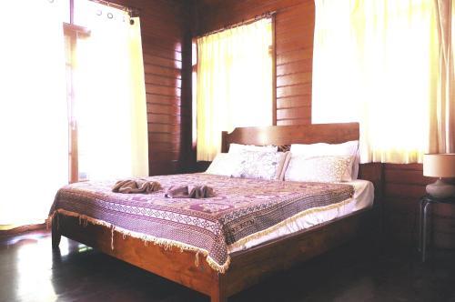 Postel nebo postele na pokoji v ubytování Thai House Beach Resort