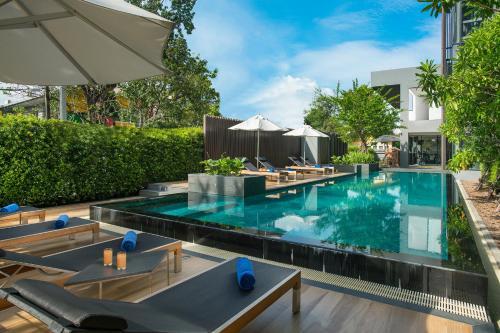The swimming pool at or near Somerset Ekamai Bangkok
