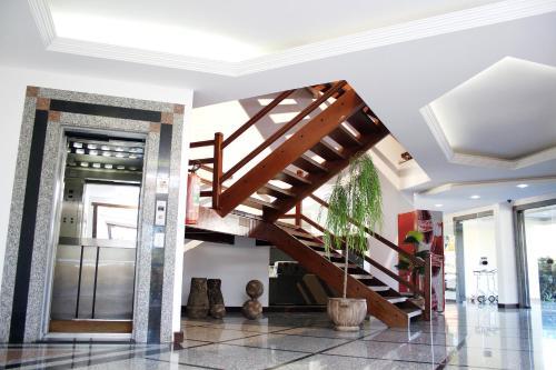 O saguão ou recepção de Hotel Caiçara Bistrô e Eventos Ltda