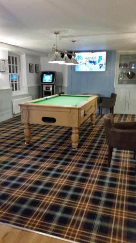 A pool table at Tyacks Hotel