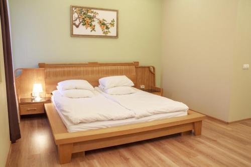 Кровать или кровати в номере Бутик-Отель Столица
