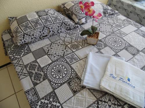 A bed or beds in a room at Hotel Val Paraiso