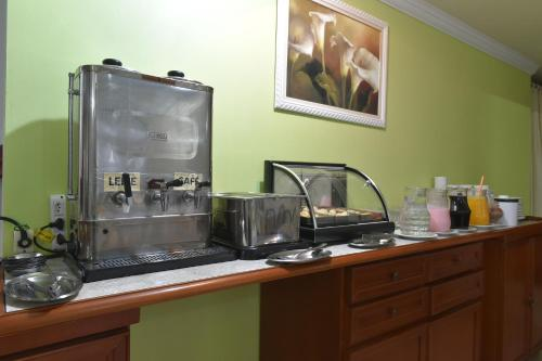 A kitchen or kitchenette at Hotel Cabanas Alto Da Serra