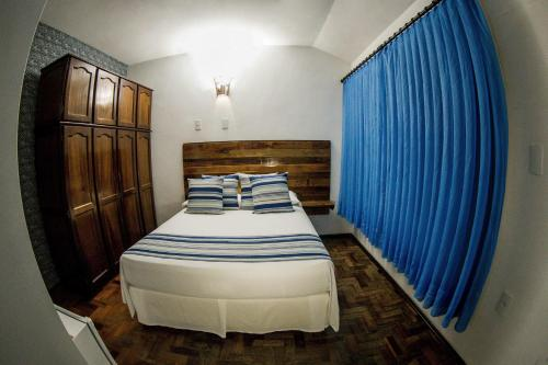 A bed or beds in a room at Pousada Casarão
