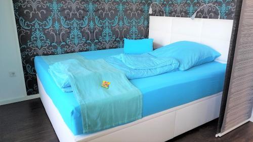 Ein Bett oder Betten in einem Zimmer der Unterkunft Messeapartment stylisch & citynah