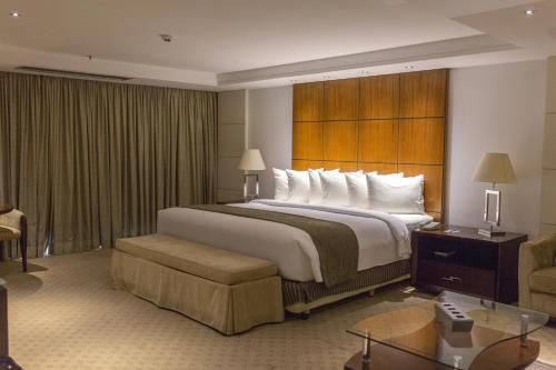 A bed or beds in a room at Grand Bittar Hotel