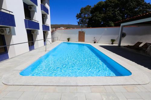 A piscina localizada em Hotel Porto do Sol ou nos arredores