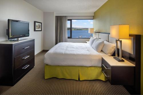 A bed or beds in a room at The Hollis Halifax - a DoubleTree Suites by Hilton