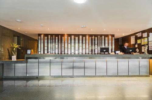 O saguão ou recepção de Phenícia Bittar Hotel