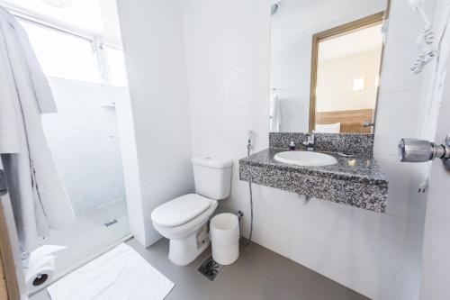 Um banheiro em América Bittar Hotel