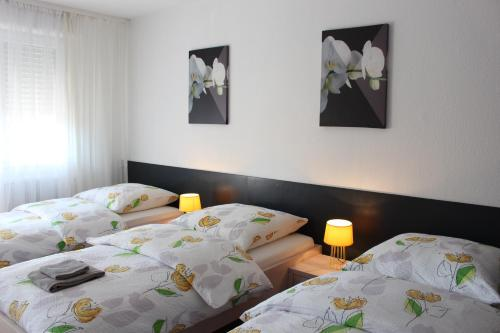 A bed or beds in a room at Studios near Basel Airport