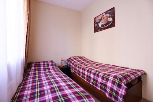 Кровать или кровати в номере Хостел Рус - Волгоградка
