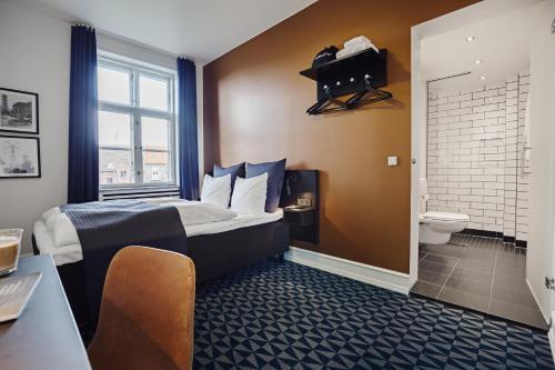 En eller flere senge i et værelse på Milling Hotel Ritz Aarhus City