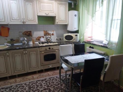 Кухня или мини-кухня в Vacation home U Iry