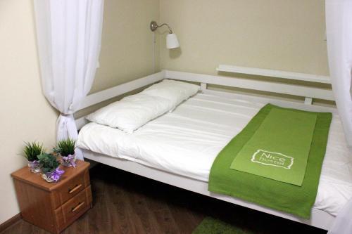 Кровать или кровати в номере Nice Krasnye Vorota