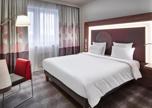 A bed or beds in a room at Novotel Moscow Kievskaya