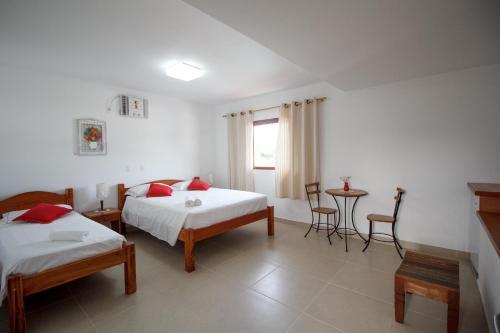 Cama ou camas em um quarto em Pousada Acqua Azul
