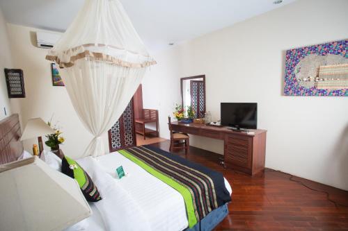 Кровать или кровати в номере Amata Resort & Spa, Ngapali Beach