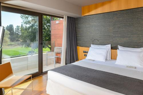 A bed or beds in a room at Alexander Beach Hotel & Spa