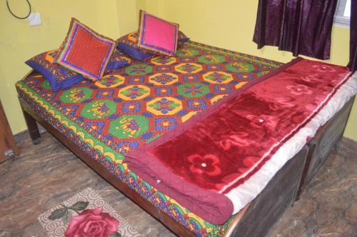 A bed or beds in a room at Azure Family Paying Guest House
