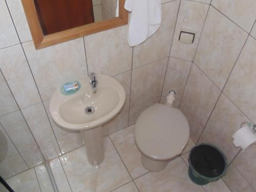 Um banheiro em Chales Marigu
