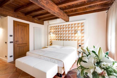 Letto o letti in una camera di Ferrara Rooms