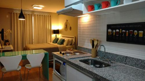 A kitchen or kitchenette at Apto Novo e Completíssimo