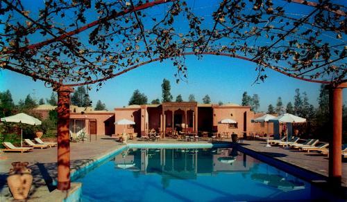 The swimming pool at or near Al Moudira Hotel