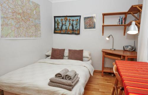 A bed or beds in a room at Brecknock Road House
