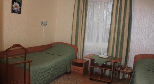 Кровать или кровати в номере Отель  Лут