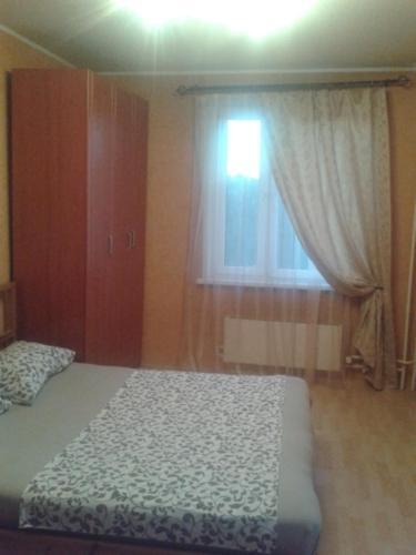 Кровать или кровати в номере Апартаменты на Лескова 5