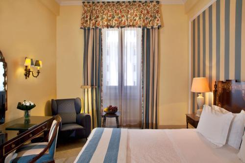 Кровать или кровати в номере Hotel Avenida Palace