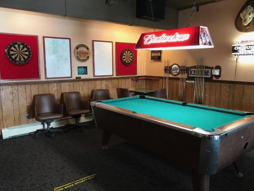 A pool table at Shelikof Lodge