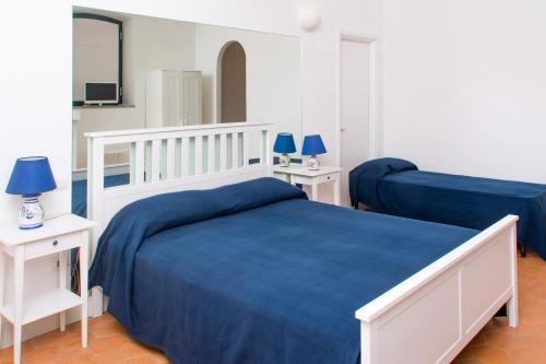 A bed or beds in a room at La Belle Vie B&B