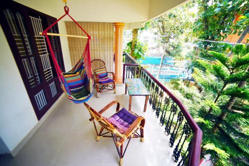 A balcony or terrace at Aryavilla Heritage