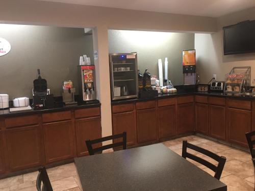 A restaurant or other place to eat at Super 8 by Wyndham Newton