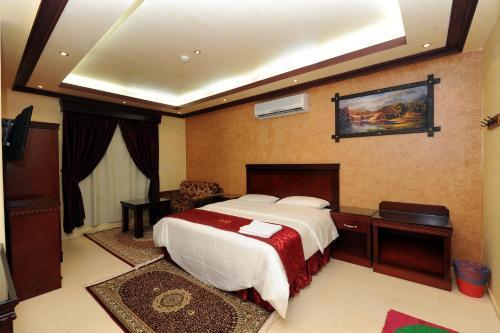 Cama ou camas em um quarto em Aknan Al Nafil Furnished Units