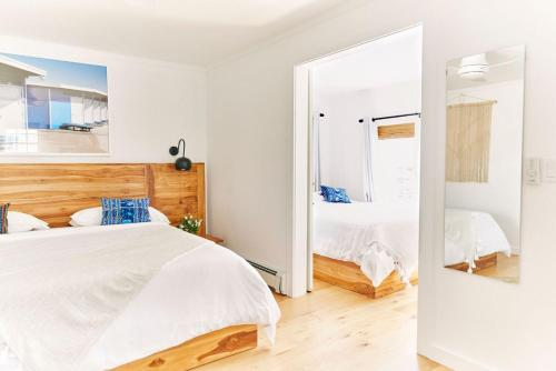 A bed or beds in a room at Hero Beach Club